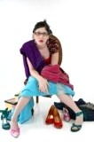 800273-woman-in-formal-chair-surrounded-by-shoes-and-dresses-frustrated-with-shopping